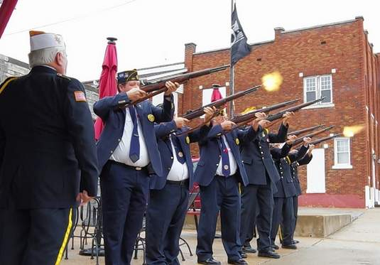 A combined Honor Guard of VFW Post 3553 and American Legion Post 487 fires a salute to fallen comrades.