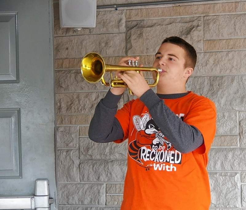 "Chester High School trumpet player Blake Zappa performs ""Taps"" to close the program."