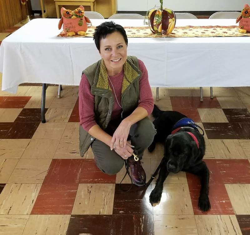 Behesha Doan, founder and executive director of This Able Veteran and Extreme K-9 of Carbondale, with service dog Lobo.