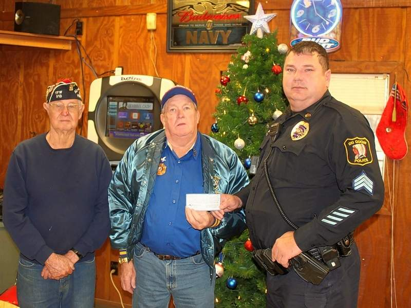 Du Quoin VFW Post 513 present a $250 check to the Du Quoin Police Department's Shop-with-a-Cop program, to be held Dec. 4 for area children. From left are VFW Commander Archie Hampleman, VFW Auxiliary President Cotton Brayfield and DuQuoin Police Sgt. Chris Robinson.