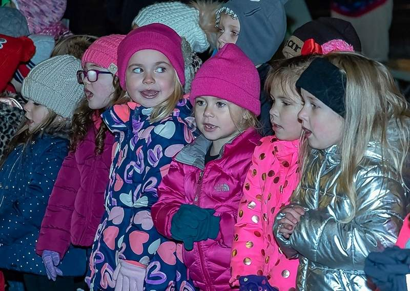 Excited children wait for the tree lighting.