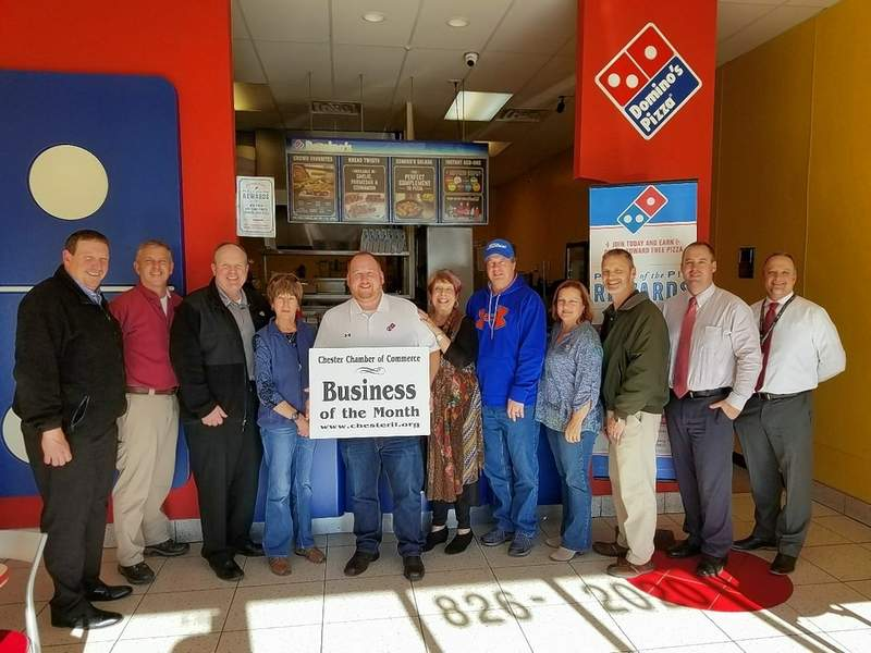 Members of the Chester Chamber of Commerce board gather Jan. 8 to salute Domino's Pizza as the first Business of the Month. From left are Dan Colvis, Bob Welker, Tom Welge, Linda Sympson, Nick Burch, Gwendy Garner, Ron Woodworth, Marge Sanders, Robert Schremp, Bruce Luthy and Brett Bollmann.