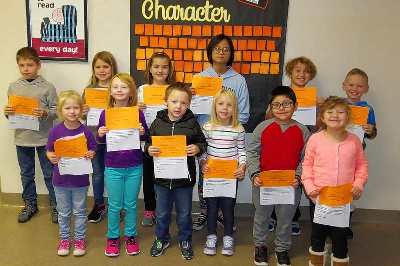 """Chester Grade School recently presented """"Passport to Good Character"""" awards to several students. Row 1, from left are  Meghan Goeke, Grace Snow, Bryceton Asbury, Addison Zavala, Nicandro Cortes and Alainah Helmers.  Back row, from left, are Anthony Keeton, Camryn Petrowske, Kaylin Jany, Bea DeGuzman, Trenton Westbrook and Brady Brown. Each child was presented with a certificate and his or her name was announced over the school PA system and on the school television."""
