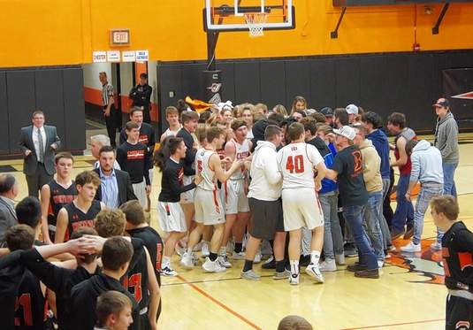 Fans and players storm the floor of Chester High School's Colbert Gymnasium, after the Jackets seal the double overtime win over Waterloo to win the 2020 CIT championship.