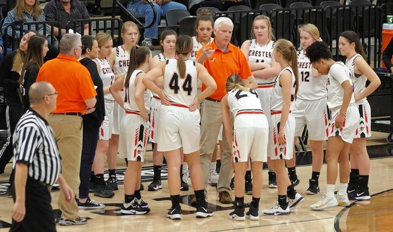 Lady Jackets Head Coach Pat Knowles talks to his team during a time out late in the game against Mt. Vernon.