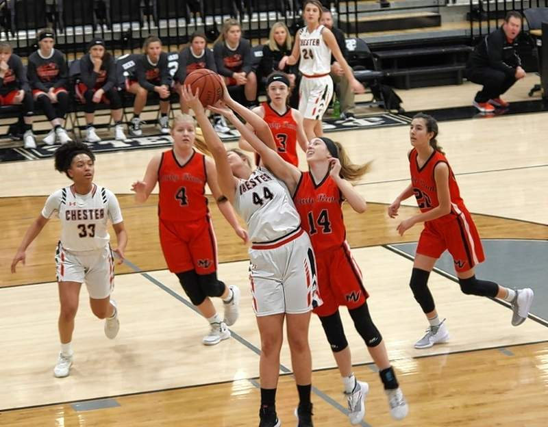 Chester's Alyssa Seymour (44) battles for a rebound against Mt. Vernon players Jacie Dees (14), Claire Heinzman (4), Kennady Hayes (3) and Ashlyn Childers (22). Chester's Destiny Williams (33) and Josie Kattenbraker (24) look on to help if needed.