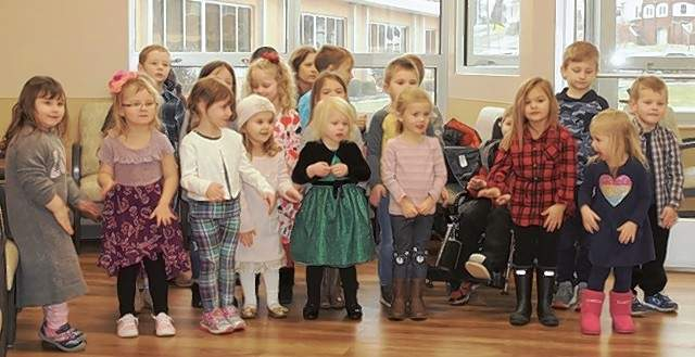 Above, St. John Pre K and Kindergarten students sing for the patients and staff at Memorial Hospital in Chester.