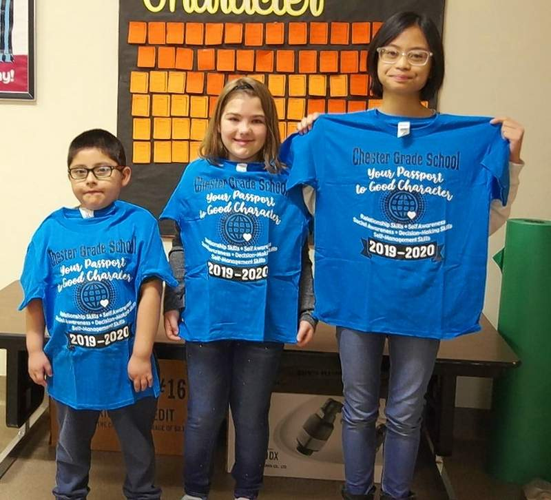 Good character winners Nicandro Cortes, left, Kaylin Jany and Bea DeGuzman were picked at random to get a Character T-shirt.