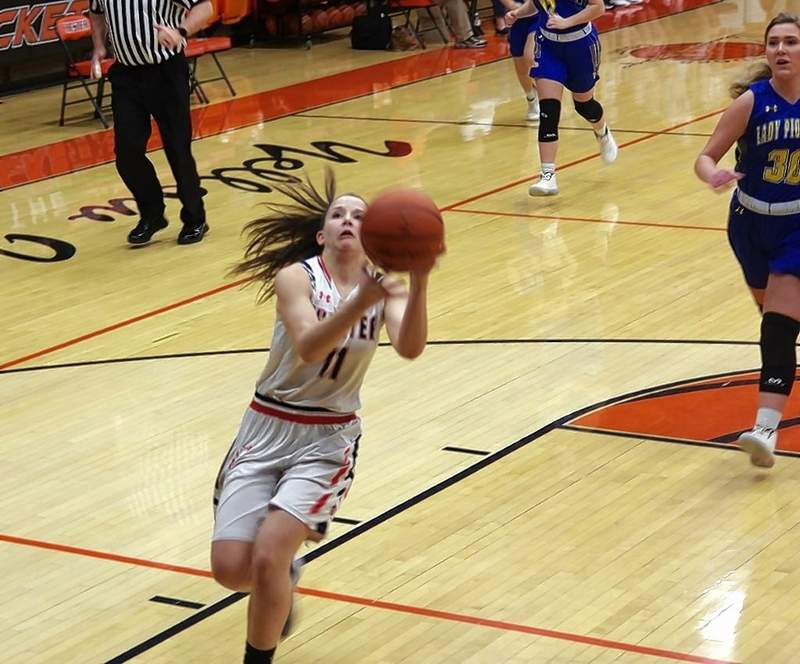 Kendall Williams (11) finishes a fast break layup at the 5:19 mark of the first quarter against Trico.