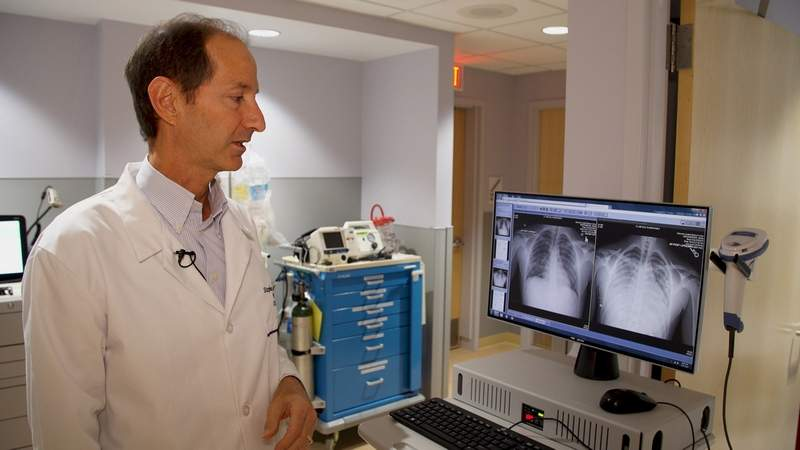 Stephen Amesbury, a pulmonologist at Advocate Condell Medical Center in Libertyville, looks at X-rays of a patient who was hospitalized after suffering from a vaping-related lung disease.