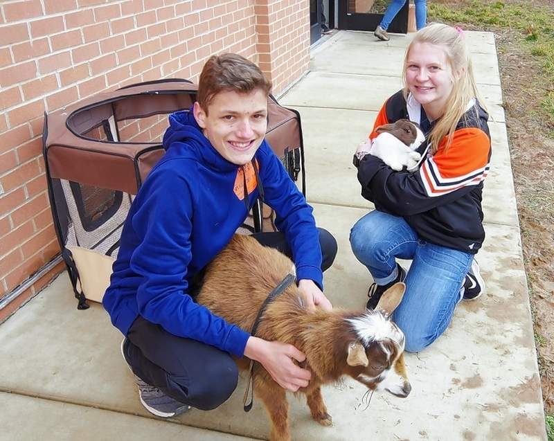 """Blake Huffman and Jessica Handel host a session on animal science"""" to 4th and 5th graders."""