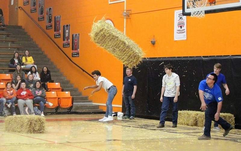 Gerald Copple, Chester High School student, wins the bale-toss contest by tossing his bale almost to half court. From left are Marisellis Malone, Andy Bryant, Dylan Todd, Shane Hayman and Copple.