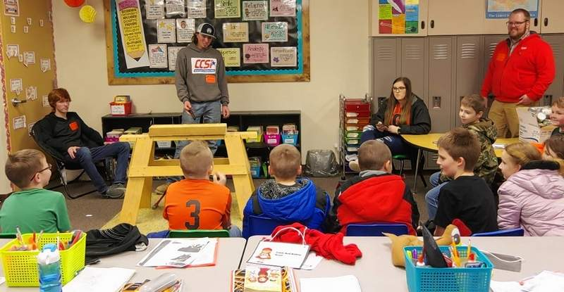 Zach Houghlan, Michael Hubert and Lauryn Vasquez present a session on carpentry at the 2020 Ag Awareness Day held at Chester Grade School.