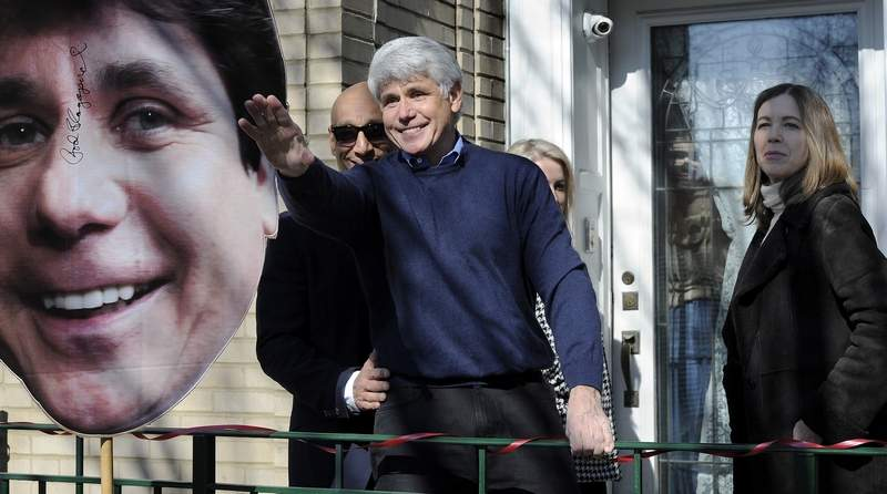 Former Gov. Rod Blagojevich waves to his friends after a news conference at his Chicago home Feb. 19, one day after his federal prison sentence was commuted by President Donald Trump.