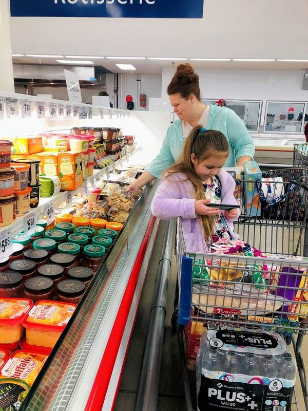 """Janeece Ball of Murphysboro and daughter Kimberlyn, stocked up on groceries at Sams Club in Marion before the """"shelter in place"""" order was made."""
