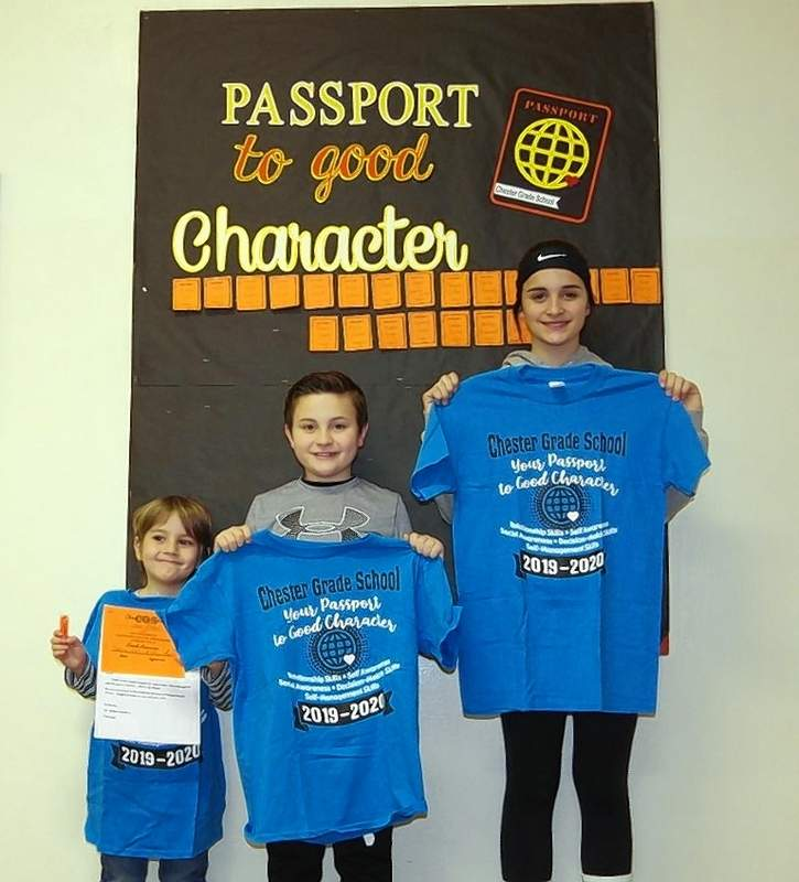 """From left, Owen Phelps, Logan Springston and Kayden King, students at Chester Grade School, were winners of a Character Education T-shirt on Jan. 31. They were selected via a random drawing from among all of the individual character award honorees for the period who demonstrated """"Social Awareness."""""""