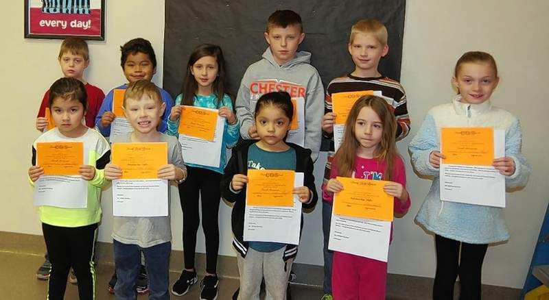 """On Jan. 10, Chester Grade School students were recognized with a """"Passport to Good Character Award."""" front row, from left, are Karmin Jara, Conner Draves, Kaylee Hernandez-Huerta, Saphera Luers and Kaylee Cowell. Back row, from left, are Michael Martin, Edwin Marquez, Mira Helmers, Robbie Myers and Keegan Loyd. Each student received a certificate."""