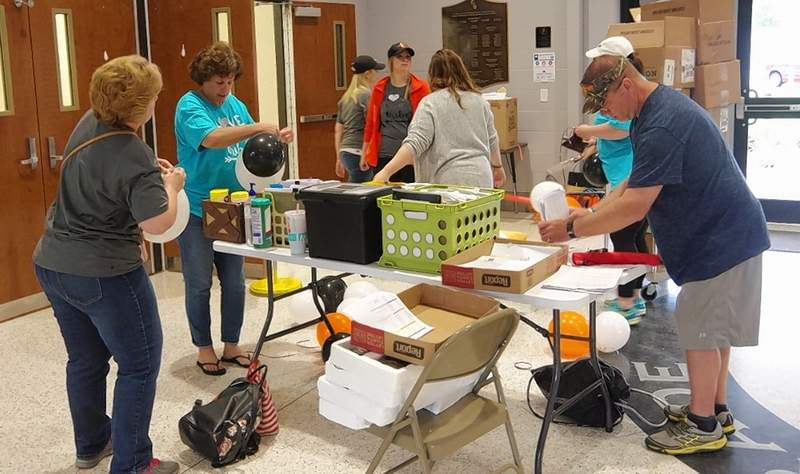 Chester Grade School teachers and staff gather in the morning of May 15 to prepare items to be delivered to all 74 members of the graduating class of 2020.