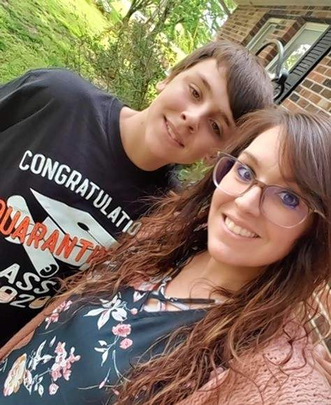"Chester Grade School 2020 graduate Colin Ezzell poses for a photo with his mother Lyndsay Roche, following the caravan visit. Colin is wearing the ""Quarantine"" T-shirt he just received. Lyndsay is the treasurer of the Chester Grade School PTS which provided the shirts."