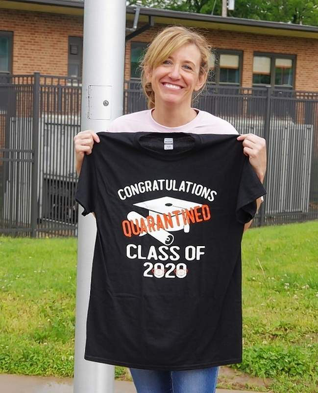 Nicki Wingerter shows off one of the T-shirts that were given to each of the 74 8th grade students in their gift bags. Wingerter's daughter, Mabry, designed the shirt with the help of several teachers.