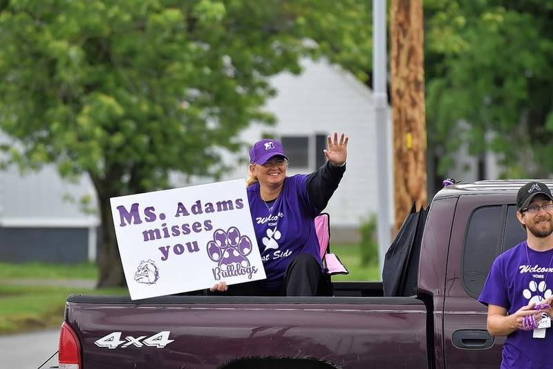 Teachers at West Side Primary wave to students at the Summer Send-Off Tuesday.