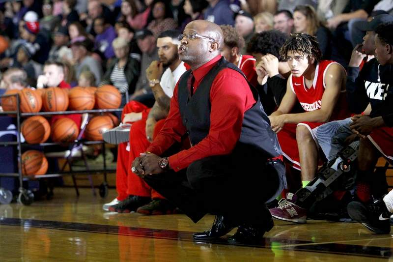(Top) Erik Griffin, a 1986 graduate of Carrier Mills-Stonefort and pictured coaching for Meridian High School, has dealt with his fair share of racial injustice both as a player and as a coach.