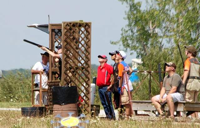 Participants in the Amateur Trapshooting Association's Academics Integrity Marksmanship youth shoot watch the sporting clays competition at the World Shooting and Recreational Complex in Sparta.