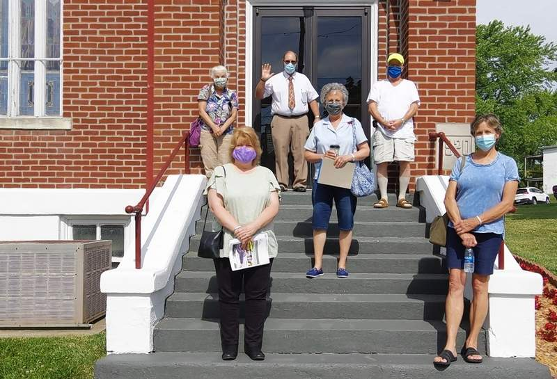 The First United Methodist Church COVID-19 Committee in front of the church. Front row, Vicky Beers, left and Pat Koenegstein. Row 2, Donna Clendenin. Row 3, from left, Kathy Belcher and Steve Belcher; Row 4 is Pastor Jim Oppedal. Not pictured: Gwendy Garner, Jim Beers, A.G. Bierman, Bob Buckham and Judge Richard Brown.