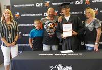 Graduate Trent Bierman, center, with CHS Principal Missy Meyer (far left) and his immediate family, father John Bierman, stepmother Cassie Bierman and brother Aaron Bierman.