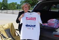 Julie Gustafson with the American Red Cross visits Chester last week to present donors at the June 17 blood drive with their commemorative St. Louis Cardinals Blood Drive T-shirts. The next Red Cross blood drive will be held 12:45-5:45 p.m. in the Chester Grade School cafeteria.