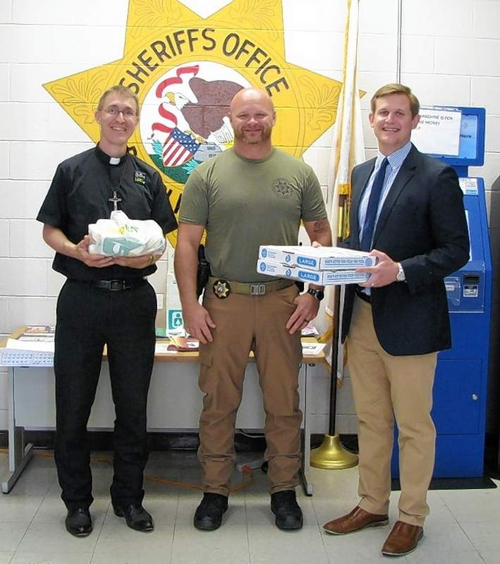 From left, Chester Lions Club Treasurer Justin Massey, Chief Deputy Jarrod Peters of the Randolph County Sheriff's Office and Chester Lions Club President Chris Koeneman.