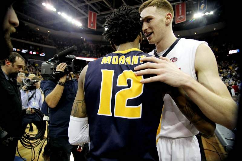 Former Murray State standout Ja Morant and Belmont's Dylan Windler shake hands following the conclusion of the 2019 Ohio Valley Conference men's basketball championship game.