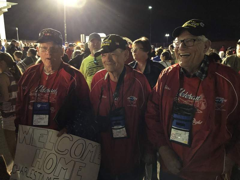 """Members of Honor Flight 6 enjoy the traditional """"Welcome Home"""" celebration at Veterans Airport of Southern Illinois on May 14, 2019."""