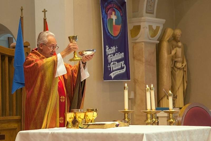Father Ken Shaefer celebrates Mass at Our Lady of Mt. Carmel in Herrin.