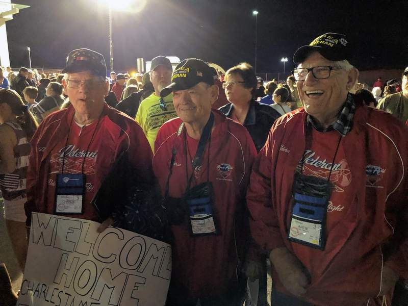Members of Honor Flight 6 enjoy the traditional 'Welcome Home' celebration at Veterans Airport of Southern Illinois on May 14, 2019.