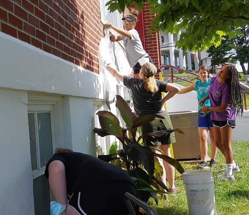 Members of the Grace Church Youth Group prepare to paint window ledges at the First United Methodist Church of Chester on Day 2 of the 3-day mission trip.