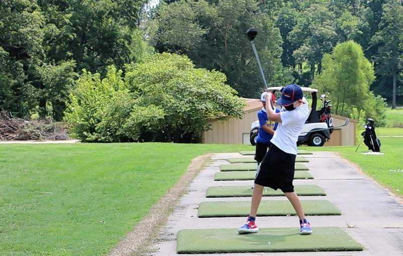 Camper Wyatt Heisel practices his swing at the Aug. 15 camp.
