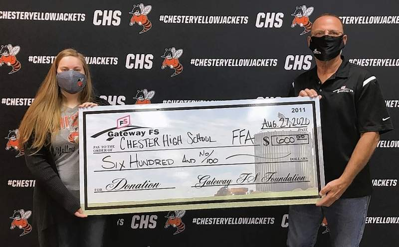 Chester High School FFA Sponsor, Emily Millburg accepts a check for $600 from Mike Pries of Gateway F/S, to be used by the CHS FFA Chapter.