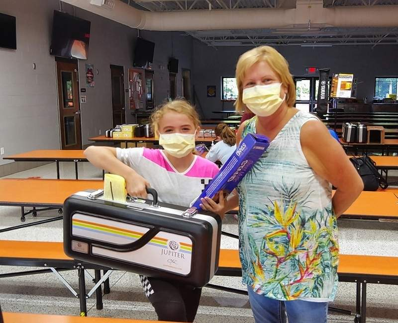 Fifth grader Justice Mattingly and her aunt Charlotte Johnson show off Justice's new alto saxophone in the CGS cafeteria.