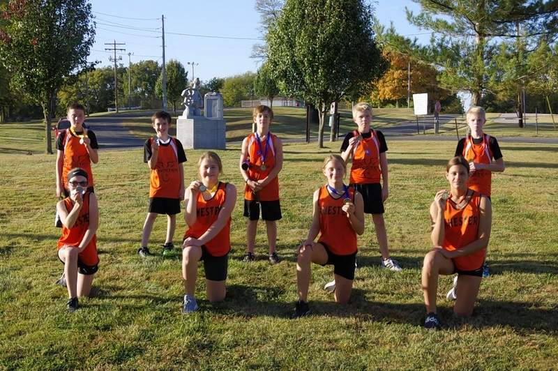 Chester's medal winners at the final CGS cross country home meet of the year Tuesday, Oct. 13. Front row, left to right: MacKenzie Deimund, Jessica Stumpe, Anna Menefee, Joshlyn Rhoden; back row, left to right: Lincoln Schroeder, Jack Kennedy, Zane Eggemeyer, Gavin Wilderman, Drew Wilderman.