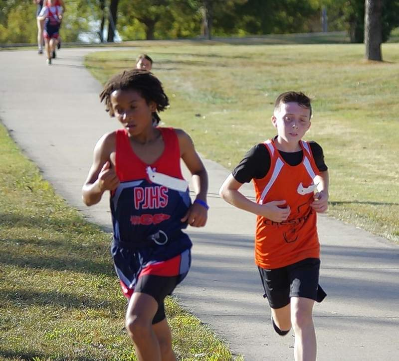 Lincoln Schroeder, right, completes his first stretch of the 1.8-mile race at the final home meet of the 2020 CGS cross country season. Schroeder held on to finish fourth overall in the varsity race to put an exclamation point on a very successful grade school home career.