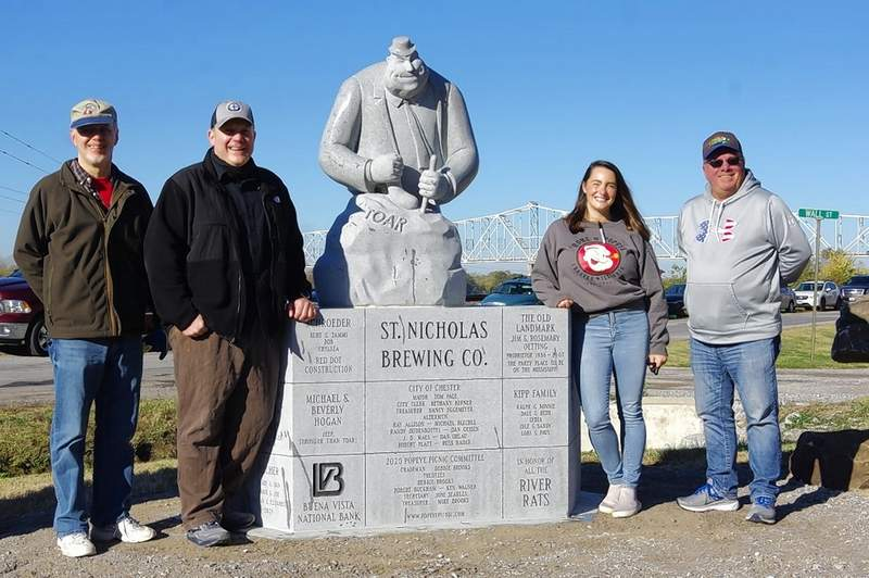 Mike McClure, founder and coordinator of the Popeye and Friends Character Trail; Tom Welge, president of the St. Nicholas Brewing Company; Abby Ancell, general manager of the St. Nicholas Brewing Company; and Mayor Tom Page of Chester, pose for a photo with TOAR, the newest statue in the Popeye and Friends Character Trail. The statue was unveiled Saturday, Oct. 31, at its location at the corner of the St. Nicholas Landmark parking lot.