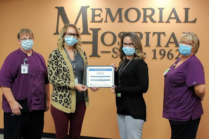 Memorial Hospital was recognized with a Pinnacle Award of Merit for its annual Go Red Event. Pictured here: Shelly Evans, cook; Mariah Bargman, event coordinator; Apryl Bradshaw, assistant coordinator; and Beth Reese, cook.