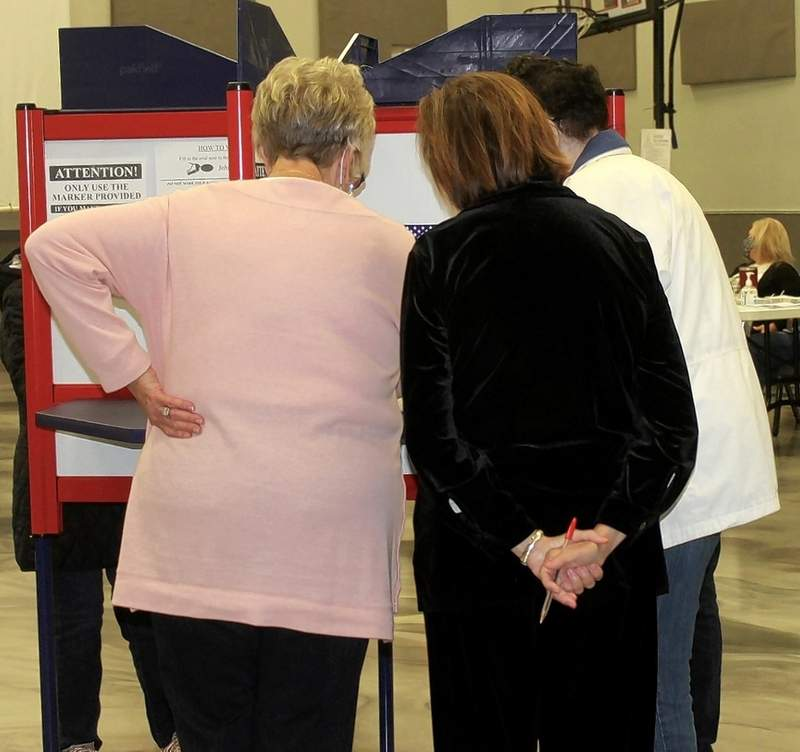 An election official explains the voting process on Election Day in Chester.