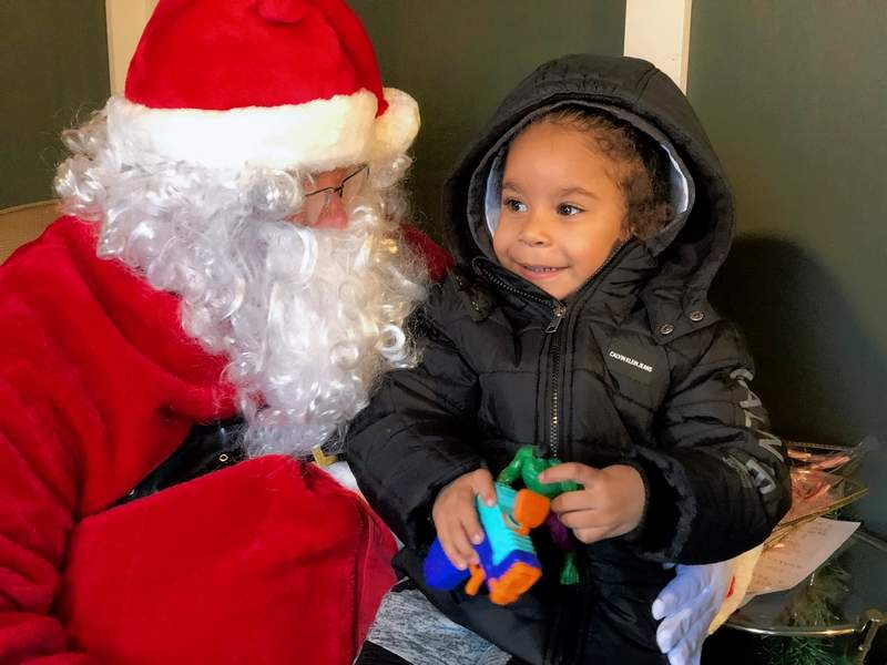 """Three-year-old Jordan Newton of Marion enjoyed his visit with Santa during last year's """"Downtown Christmas"""" on the Marion Square. The celebration will take place again with accommodations for COVID-19 in place."""