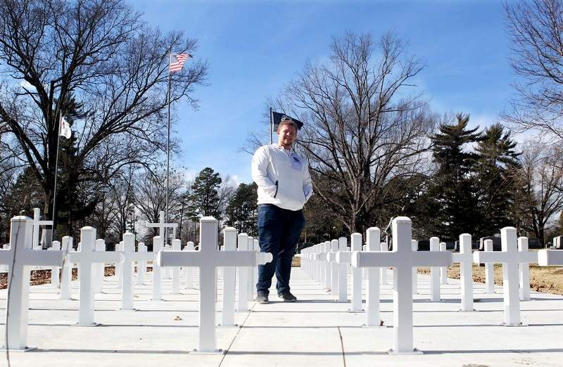 Harrisburg High School senior Blake Eversmann won the Chicago Bears' Community High School All-Star award for his work in preparing the portion of Little Arlington at Sunset Lawn Cemetery for Memorial and Veteran Day services held annually.