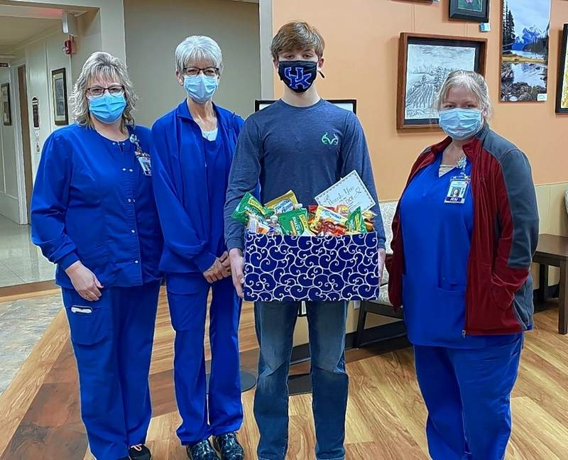 Kolton Jany, with box, delivers the collection of supplies collected by students at St. Mary's School for Memorial Hospital during Catholic Schools Week. The nurses, from left, are Angie Schoenbeck, Amy Kirkland, and Kari Schaefer.