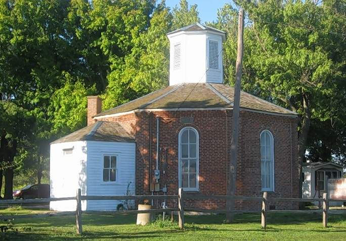 The Charter Oak Schoolhouse in Schuline was one of the small schools in Randolph County. Built in 1873, it served as a public primary school until 1953.