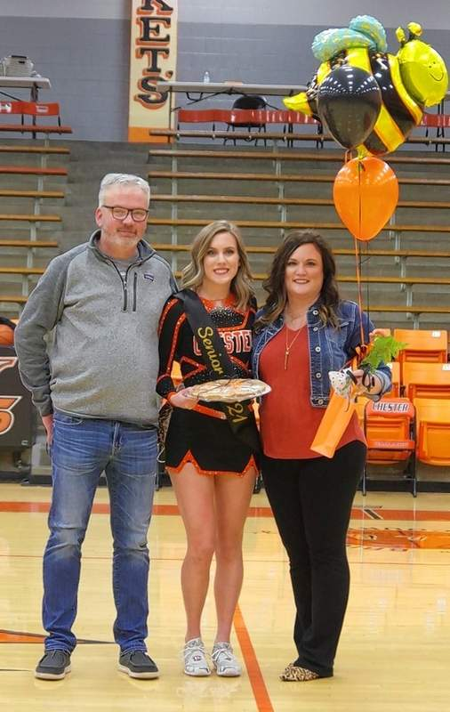 Kennedy Herrell, with parents Jeff and Alisa Herrell.