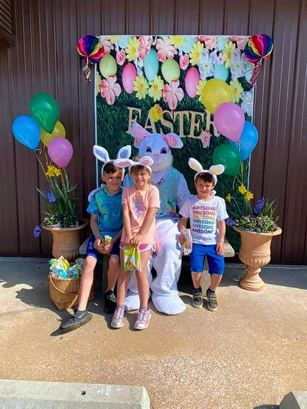 Alex Gunning, Harper Barnes and Kelton Barnes visit with the Easter Bunny for a photo.